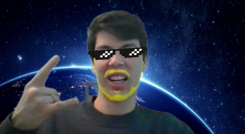 A user using the Zoom Studio Effects filters to add sunglasses and a yellow beard.