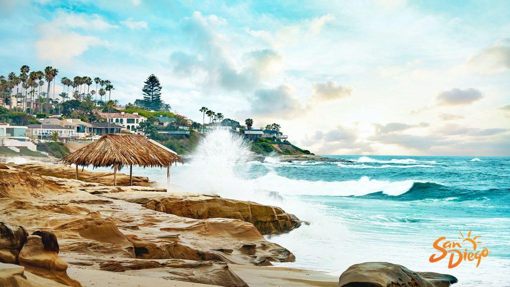 A photo of the san diego coast with waves crashing into rocks